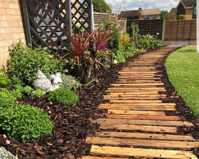 A garden pathway made with pallet wood