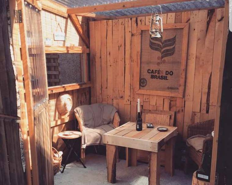 A shed made out of reclaimed pallet wood