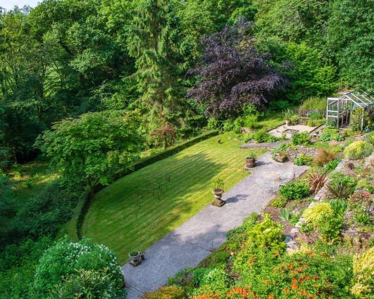 Bird's eye view of part of the Rusty Duck garden, bordered by beautiful woodland