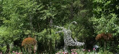 A group of sculptures in a garden