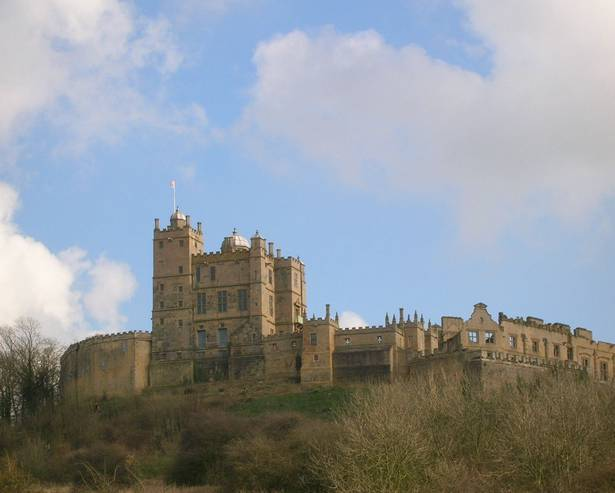 A castle on a cloudy day with Bolsover Castle in the background