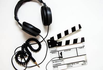 Headphones and a clapperboard