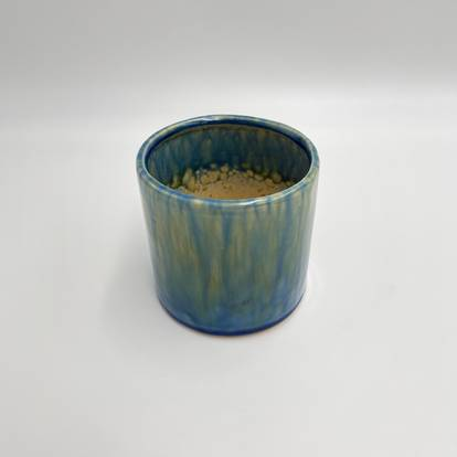 A glass with a blue cup