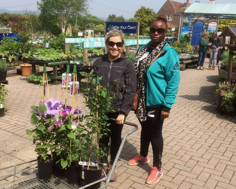 Two ladies buying plants in a garden centre
