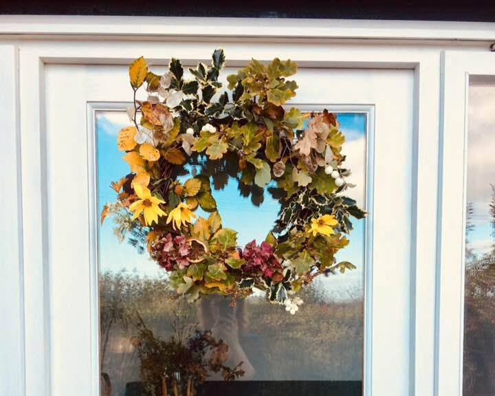 A beautiful autumn wreath on a door
