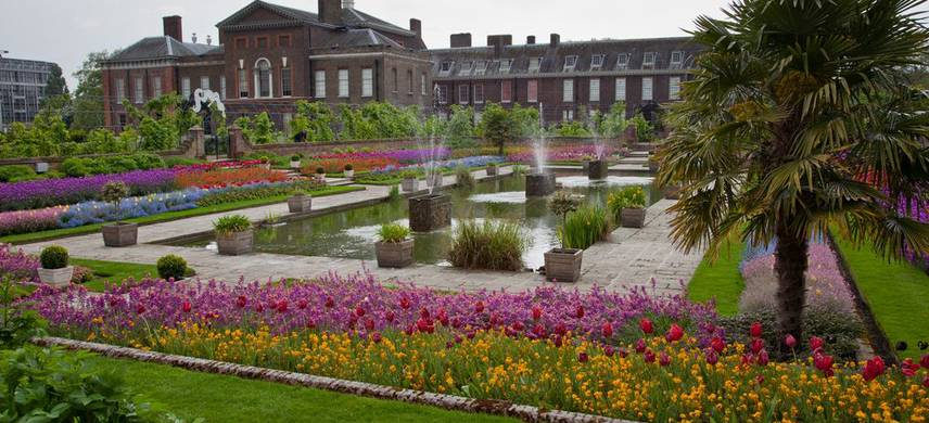 A close up of a flower garden with Kensington Palace in the background