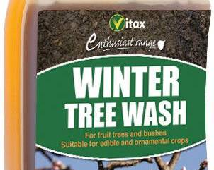 A close up of a bottle of winter tree wash